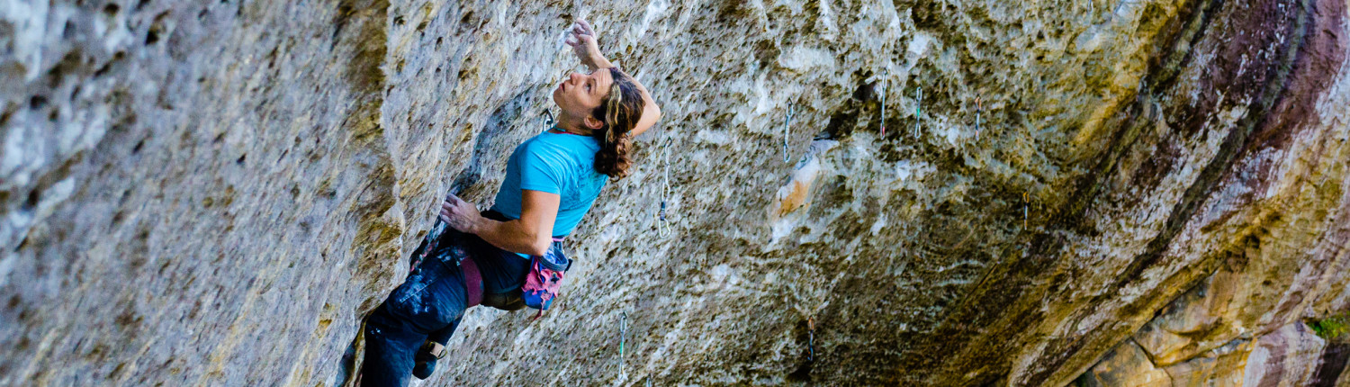 a climber performs a lock off while climbing