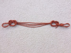 tie a second overhand on a bight to the other end of the folded cord to make a quad anchor