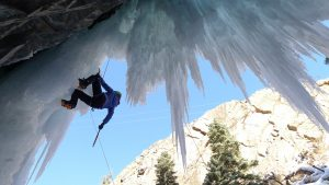 4-day ice climbing clinic participant climbing on steep ice, ouray ice park, ouray, colorado