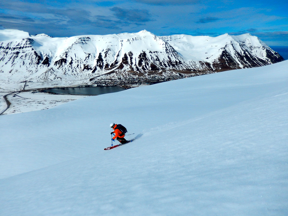 Photo of Chicks Guide Angela Hawse spring skiing in Iceland to accompany top 12 spring skiing tips