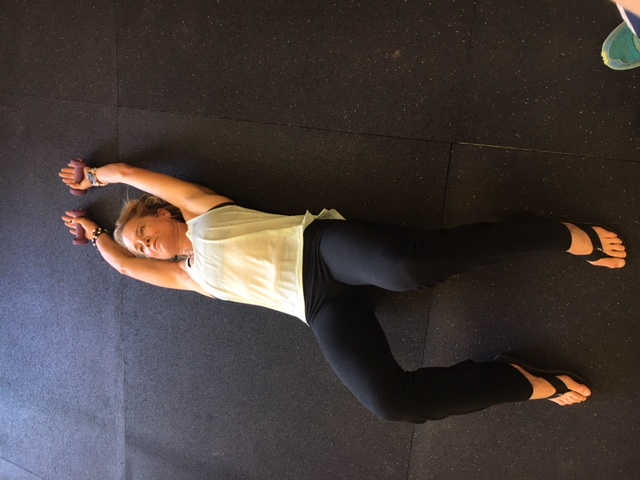 Shoulder Stretch 1. Can be done on a foam roller or bench for more stretch.