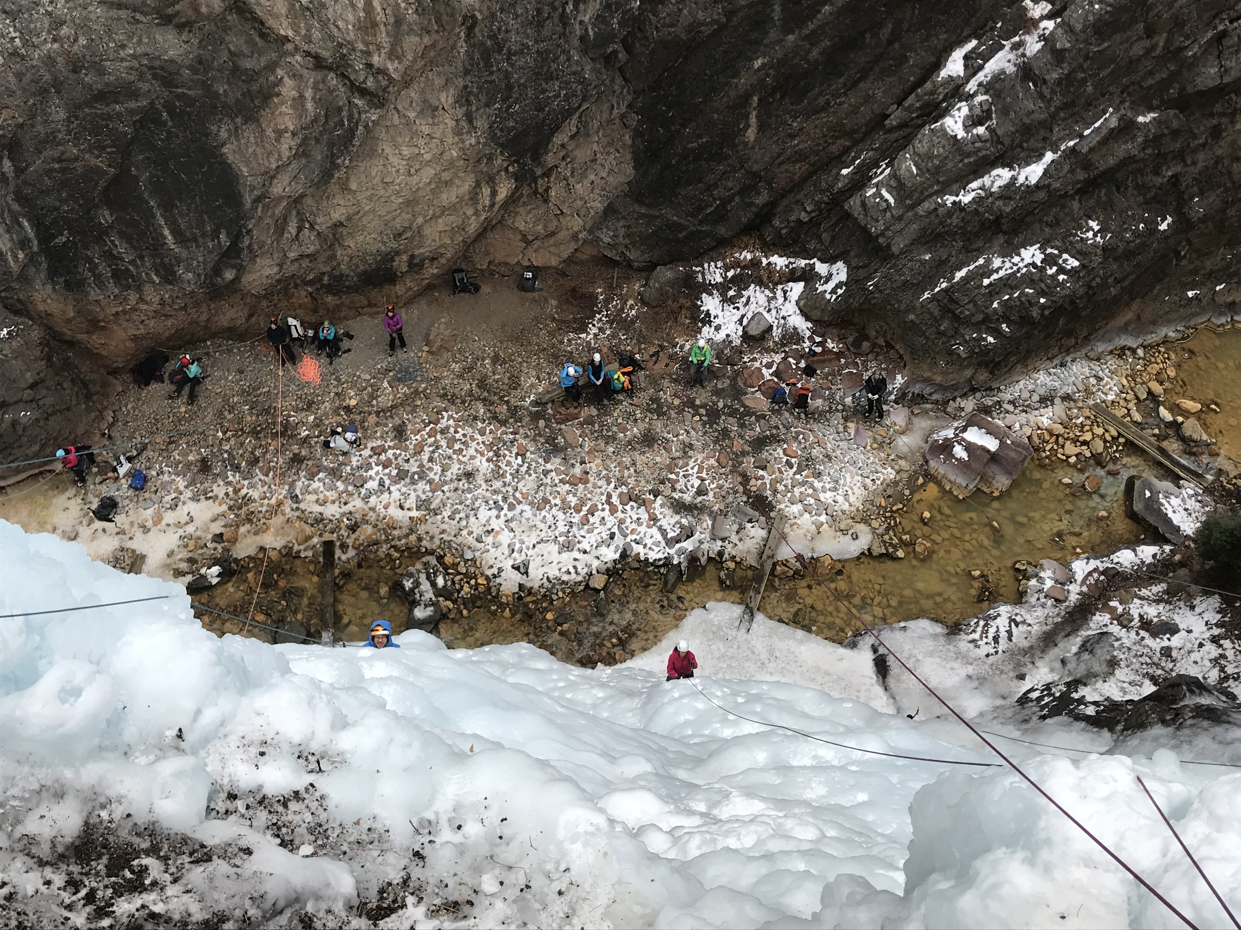 The Schoolroom, Ouray Ice Park, Colorado. Belaying top rope climbers from the other side of the river--Out of the way of the impact zone. ©Karen Bockel