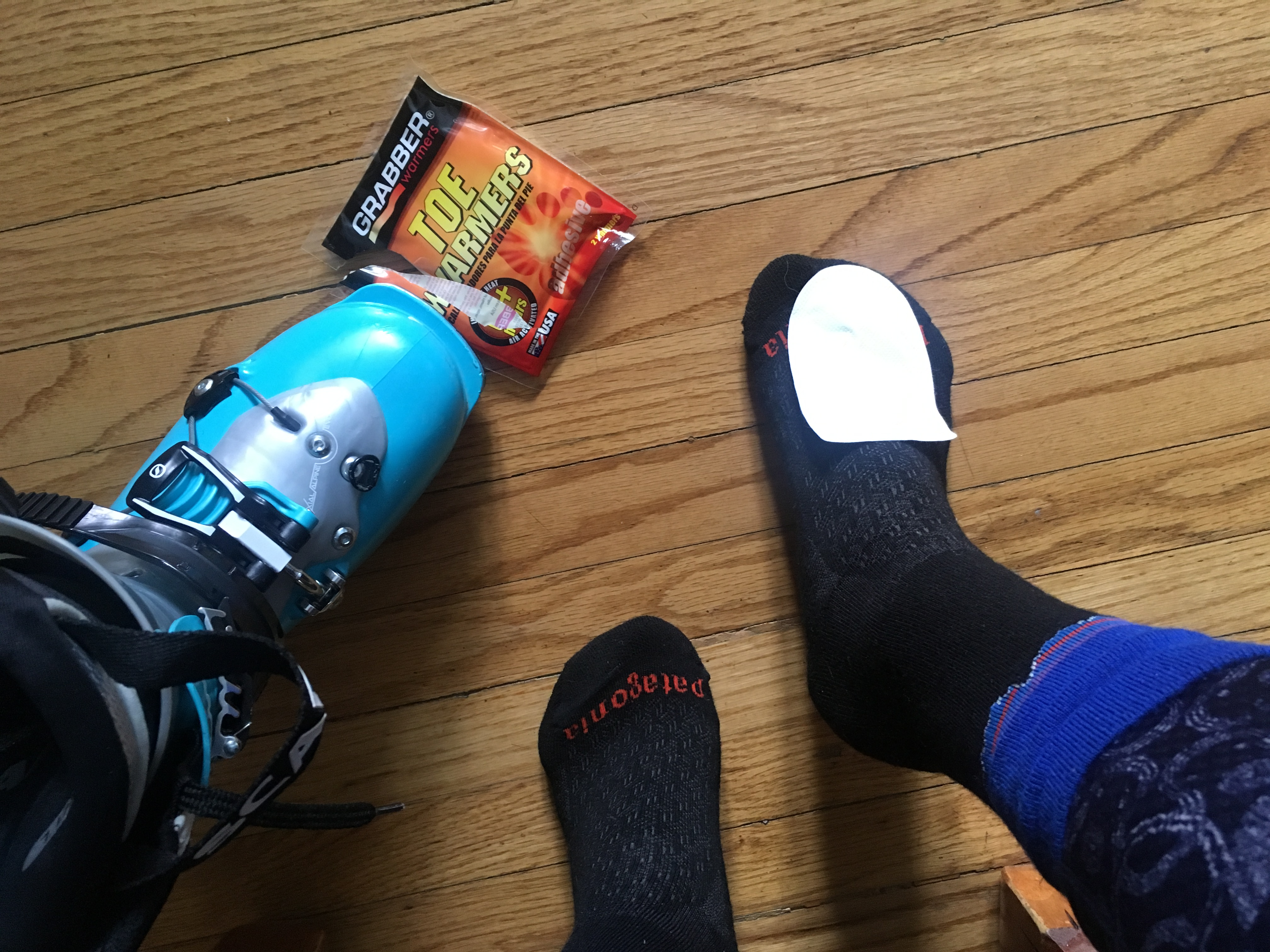 Put Grabber Toe Warmers on top of your socks