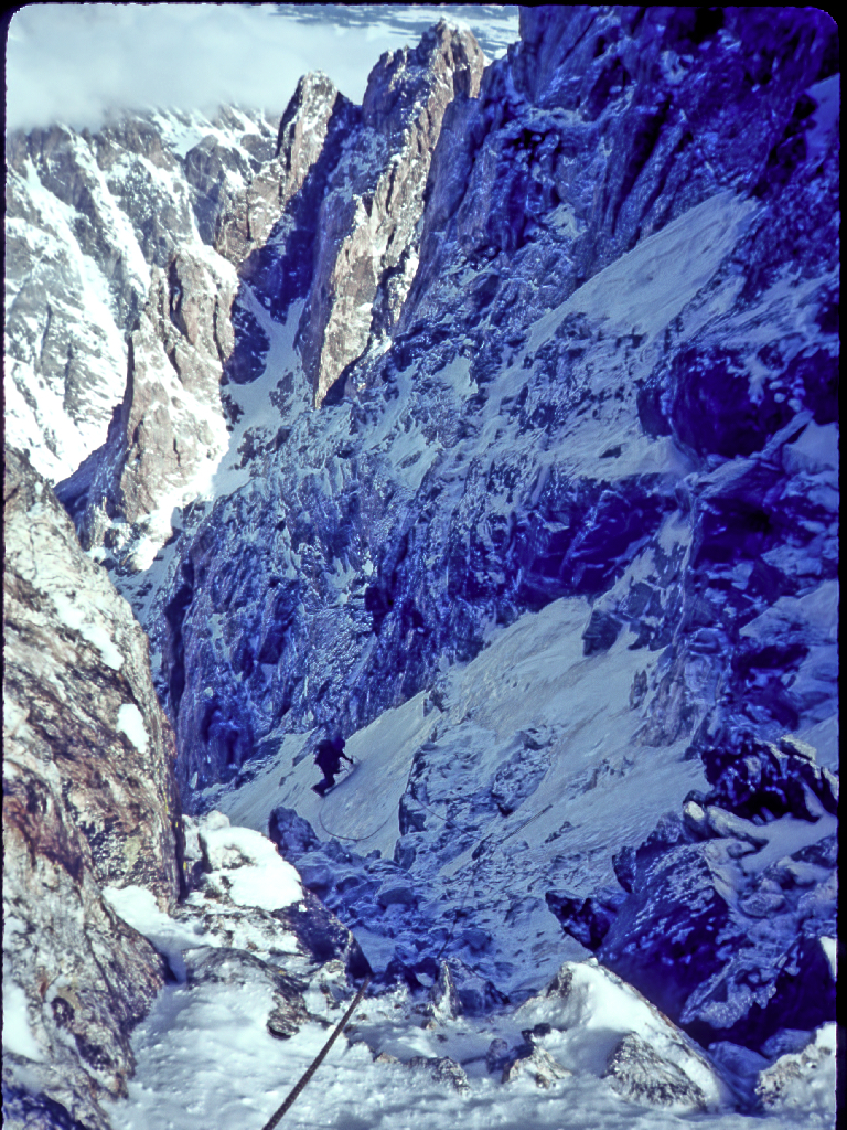 morning after unplanned bivouac. Kitty Calhoun traversing on the west face of the grand teton, 1984