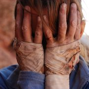 Focus on your strengths when you are having a hard time. Kitty Calhoun crying into her blood-stained hands