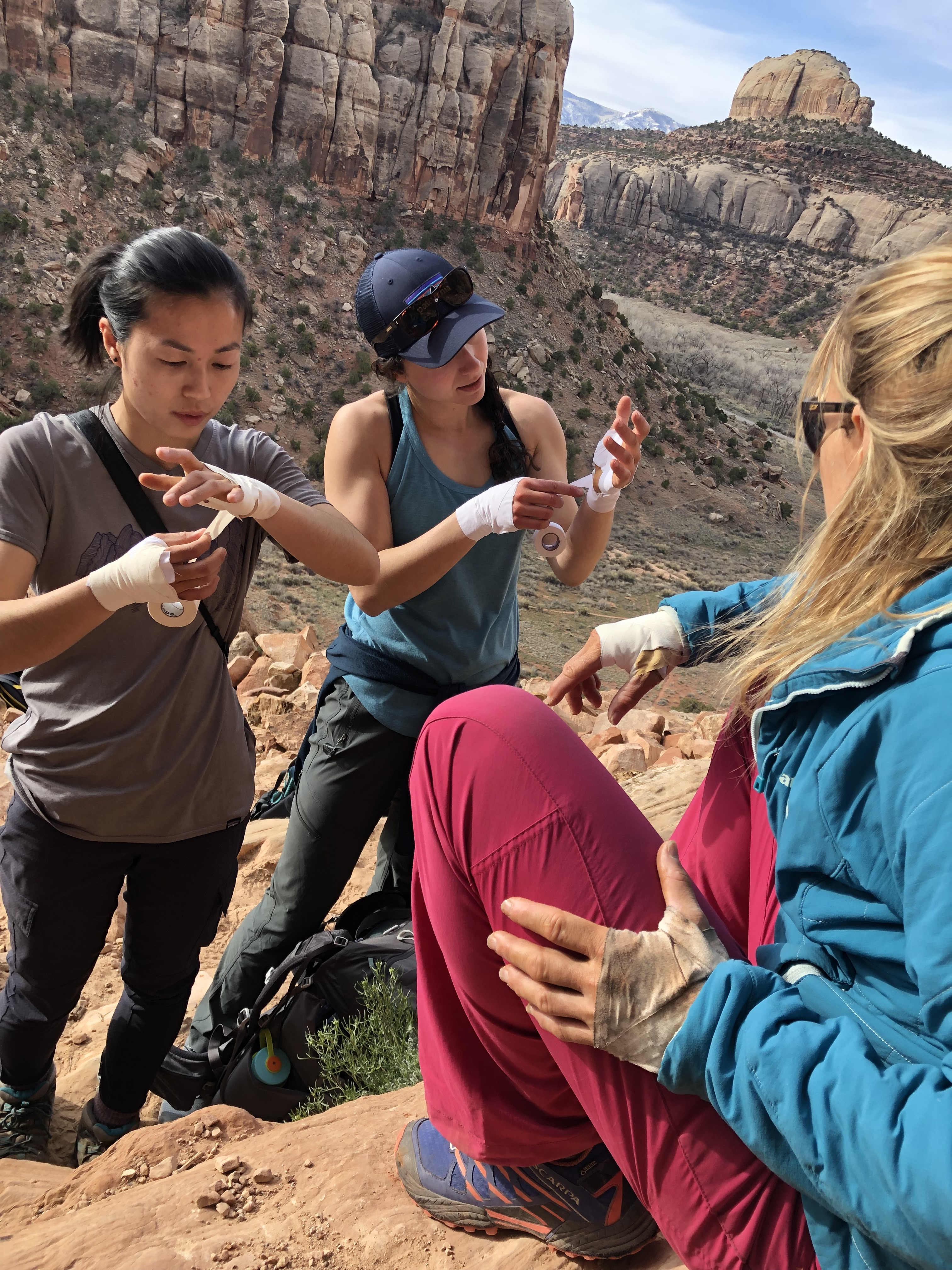 Learn more than the rest step. Kitty teaches Spring 2019 Chicks Indian Creek participants how to tape up before climbing