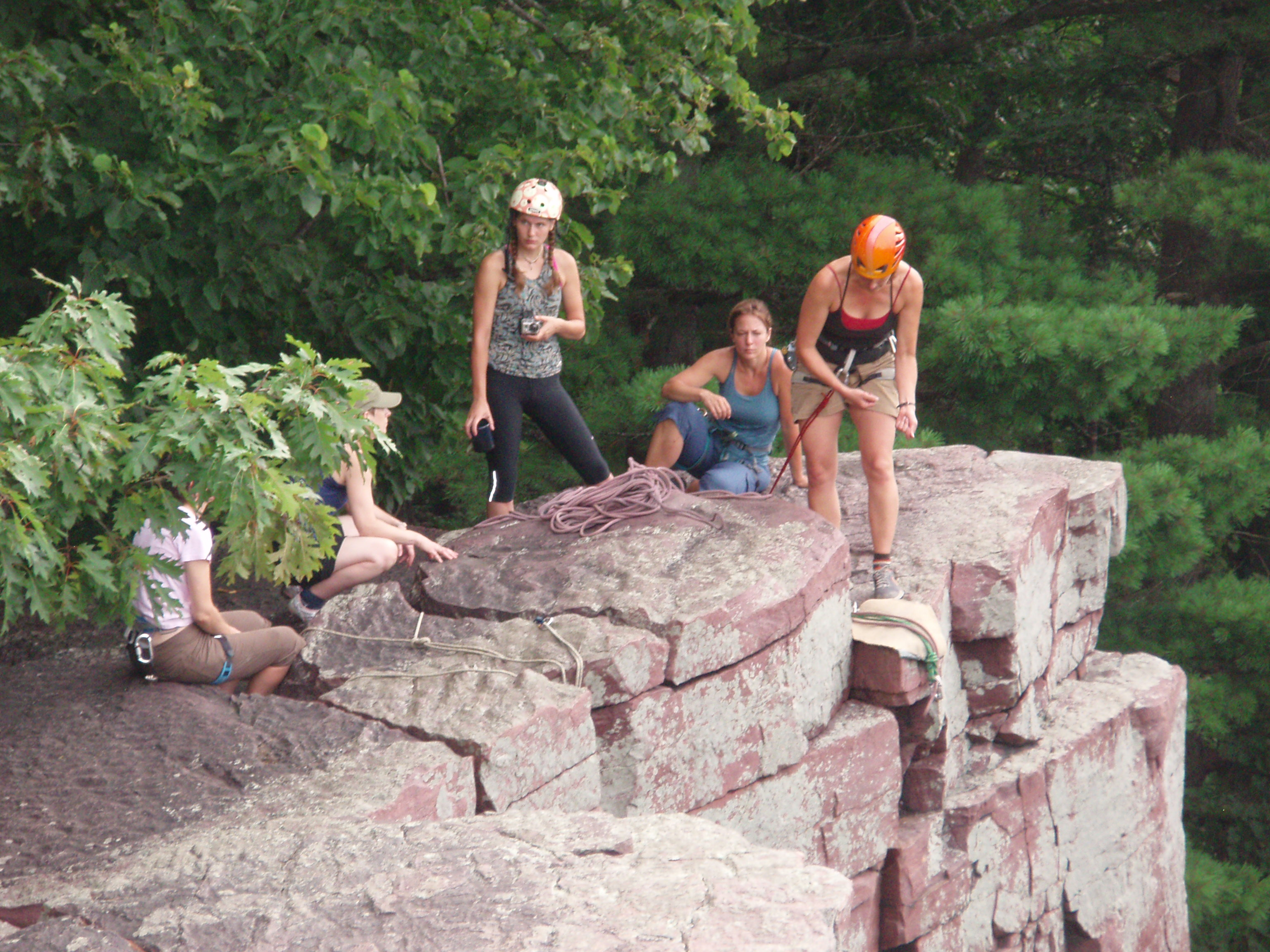 Climbing Outdoors, Devil's Lake Climbing Clinic participants learning outdoor climbing anchor systems. Devil's Lake State Park, WI.