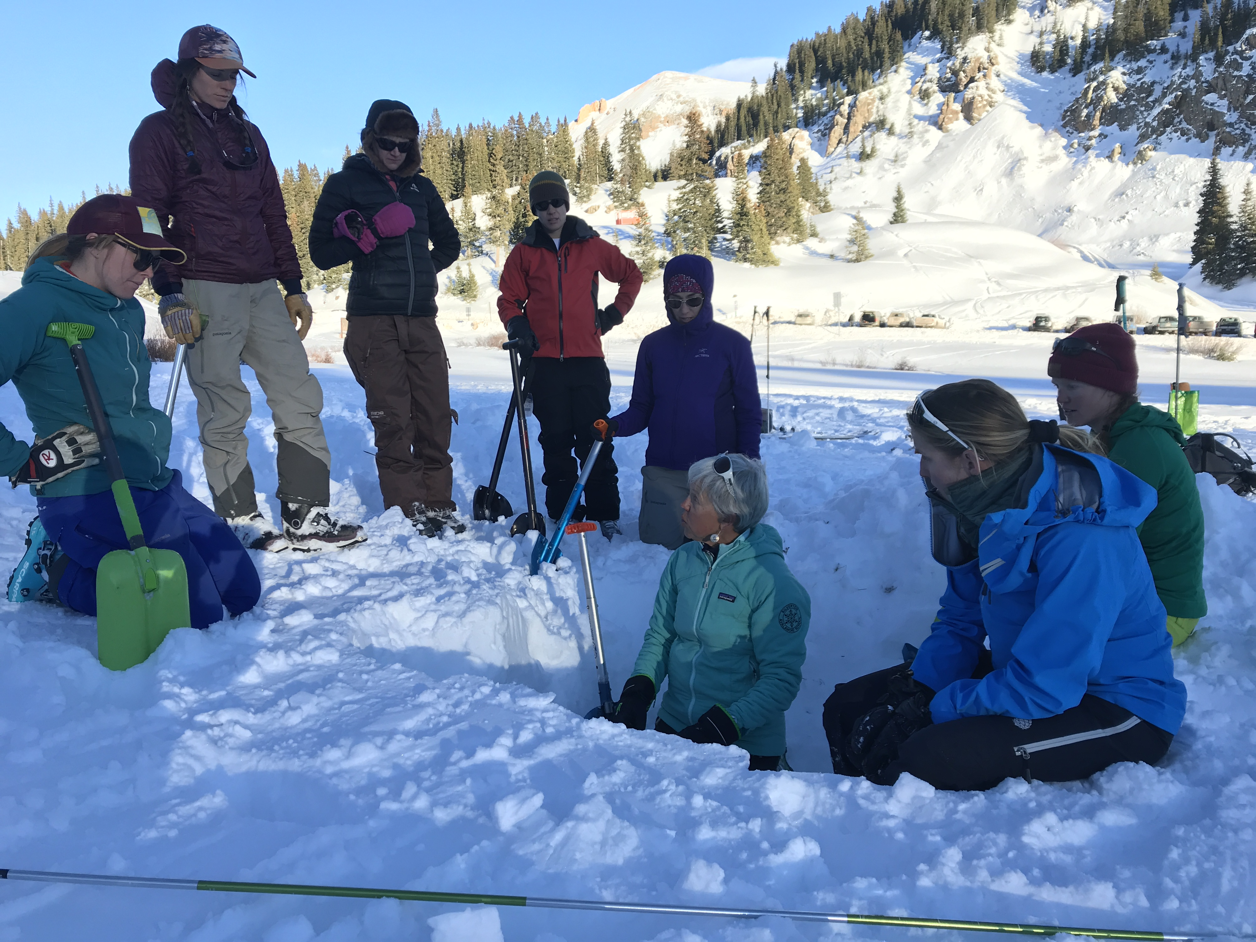 Chicks Climbing and Skiing Avalanche Rescue Course participants learning avalanche rescue skills in an all-female course