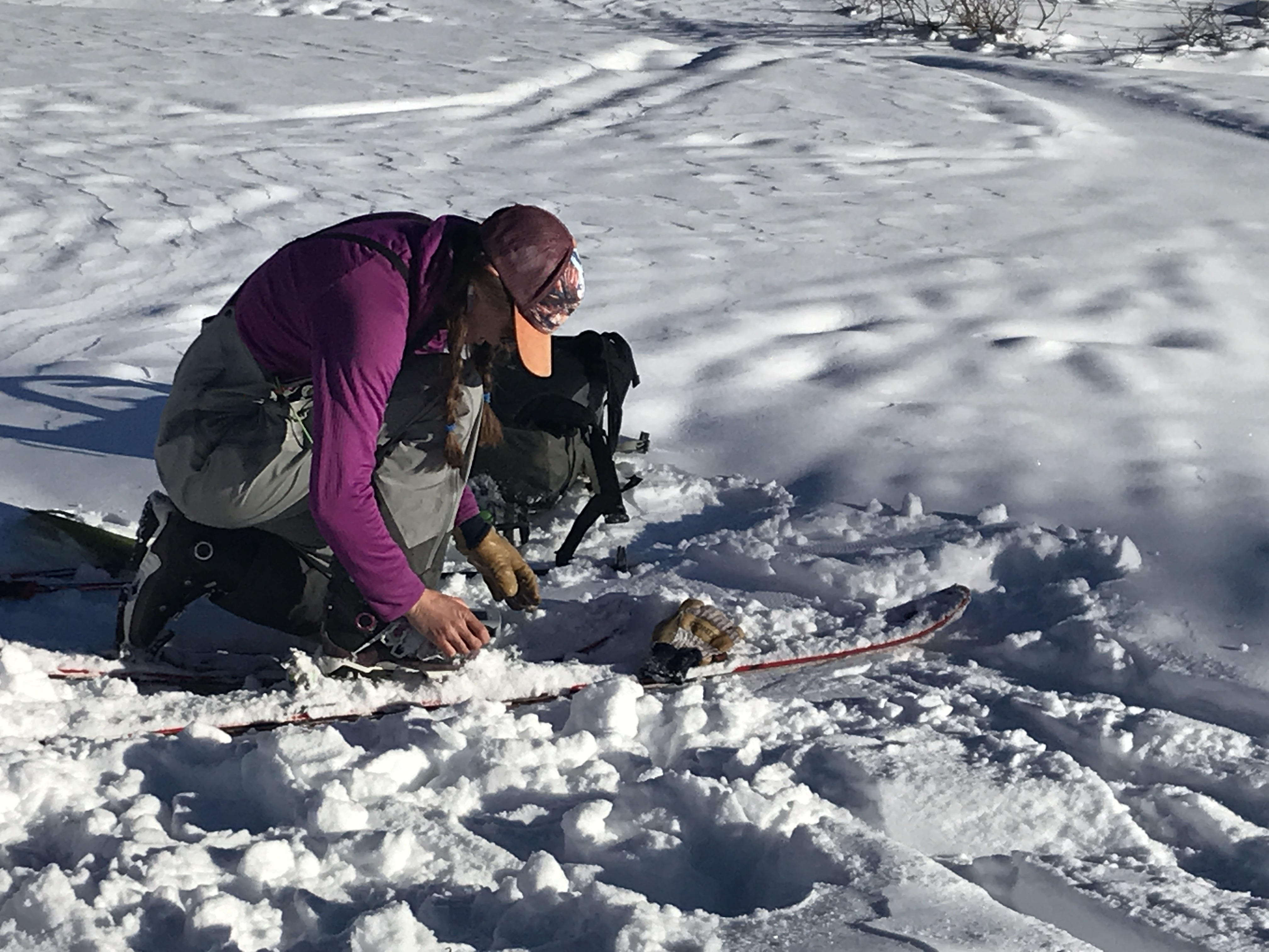 Chicks avalanche rescue course participant practices a fine search with her avalanche transceiver