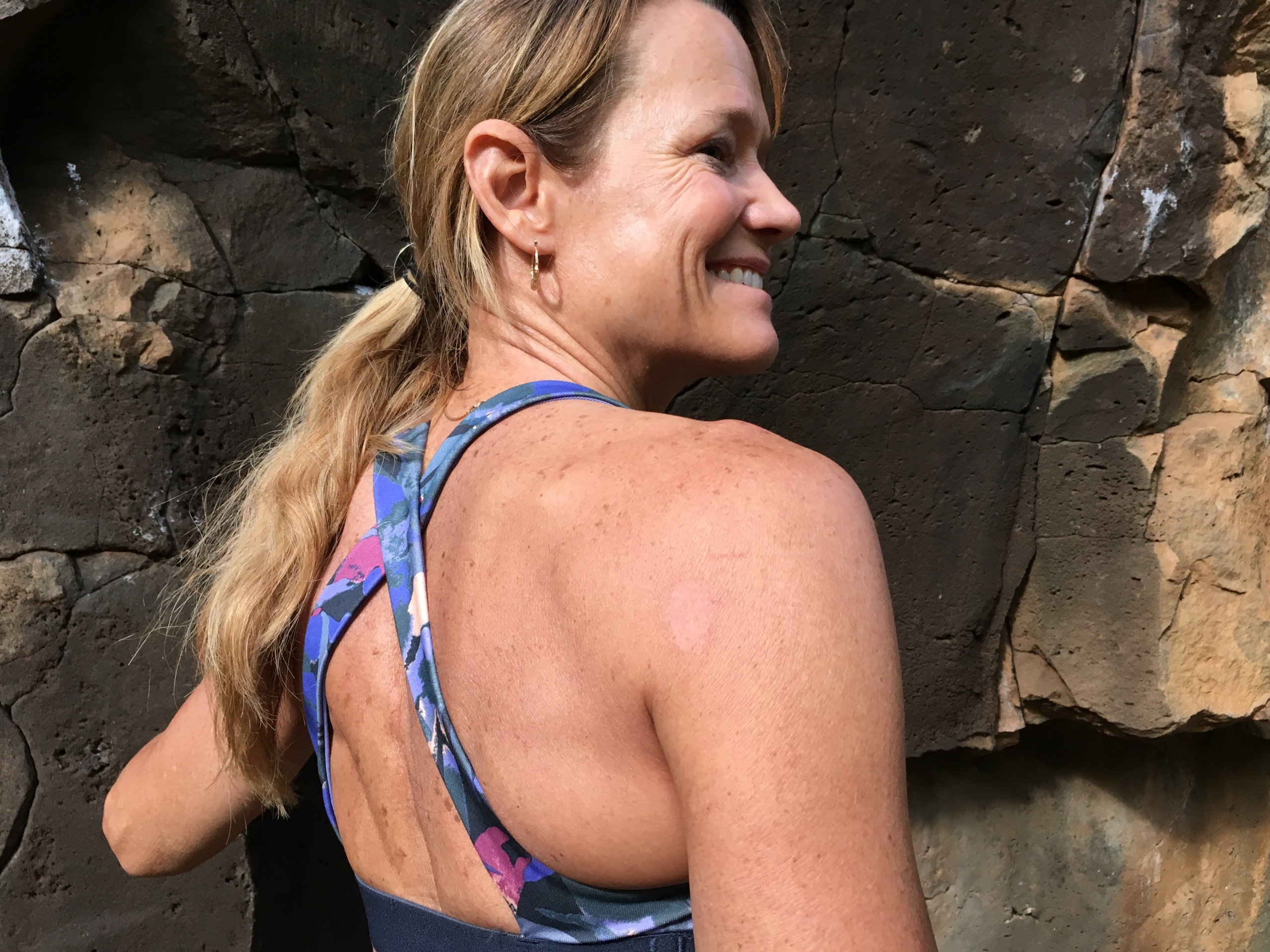 Kitty Calhoun, Co-Owner Chicks Climbing showing her Patagonia Sports Bra and Indian Creek scar on her right shoulder. ©Kitty Calhoun Collection.